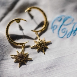 Unique bridal jewelry features moons and stars all captured by Gandee Photography