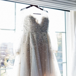 Bridal gown features sparkle and sleeves for a fall wedding coordinated by Magnificent Moments Weddings