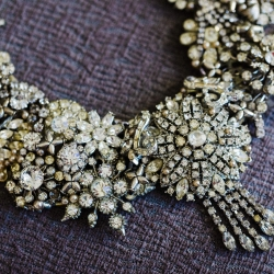 Gandee photography captures a stunning detail shot of bridal jewelry for a wedding coordinated by Magnificent Moments Weddings