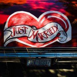 Sweet just married signs shows off the get away car during a fun wedding at Catawba Brewery
