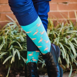Gandee Photography captures a grooms fun flamingo socks for a wedding at Catawba Brewery