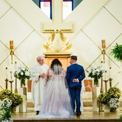 Bride and groom prepare for their ceremony at St Gabriel's Catholic Church captured by Gandee Photography