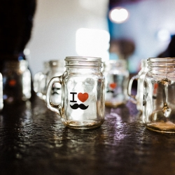 Unique wedding favors show off mustaches in a nod to the grooms own look