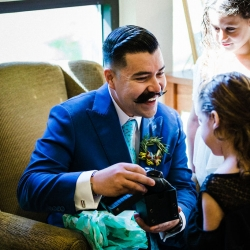 Groom opens a gift as he prepares for his wedding in Charlotte, North Carolina