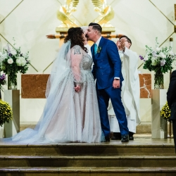 Bride and groom share a kiss after their wedding ceremony at St Gabriel's Catholic Church