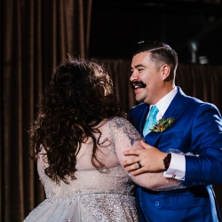 Bride and groom share a first dance to music provided by Split Second Sound during their wedding reception coordinated by Magnificent Moments Weddings