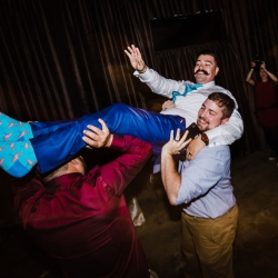 Groom enjoys dancing during his wedding reception at Catawba Brewery to music provided by Split Second Sound