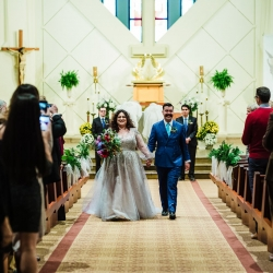 Bride and groom walk down the aisle after exchanging vows during their ceremony at St Gabriel's Catholic Church