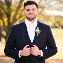 Groom poses for Grace Hill Photography during his winter wedding
