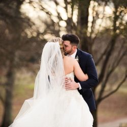 Grace Hill Photography captures a kiss between a bride and groom during their winter wedding at The Diary Barn