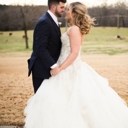 Bride and groom embrace during their winter wedding coordinated by Magnificent Moments Weddings