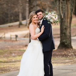 Bride and groom pose for Grace Hill Photography during their winter wedding at The Diary Barn