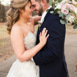 Grace Hill Photography captures a sweet moment between a bride and groom during their winter wedding