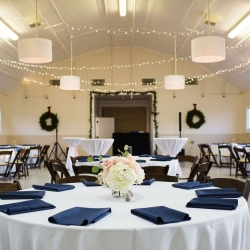 The Dairy Barn is the perfect setting for a winter wedding featuring white linens and navy napkins