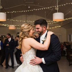 Bride and groom share a smile during their first dance to music provided by Split Second Sound