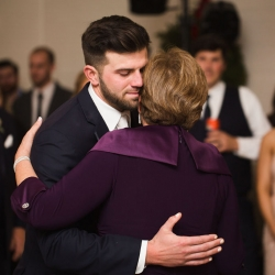 Groom shares a sweet dance with his mother during a wedding reception at The Diary Barn