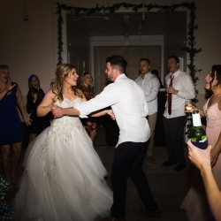 Bride and groom share a dance to music provided by Split Second Sound during their winter wedding