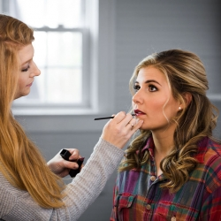 Lovely by Lindsey puts the final touches of make up on a bride for her winter wedding at The Diary Barn