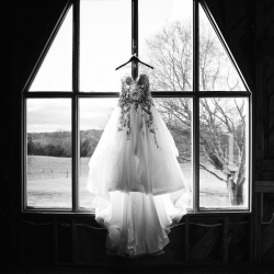 Grace Hill Photography captures a bridal gown during a winter wedding at The Diary Barn