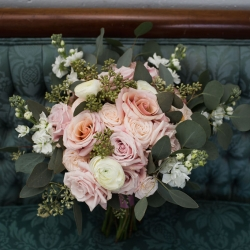 Stunning bridal bouquet features pink roses and greenery created by Buy the Bunch