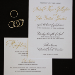 gold and black calligraphy wedding invitation