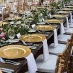 farm table set for dinner at the duke mansion