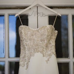 wedding gown hanging on a mrs hanger
