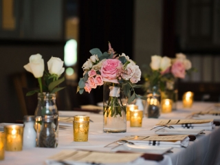 Simple rose centerpieces created by Springvine Design are the perfect accent to an intimate wedding ceremony coordinated and planned by Magnificent Moments Weddings