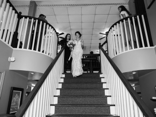 Grace Hill Photography captures a bride leaving her wedding ceremony added by her wedding planners at Magnificent Moments Weddings