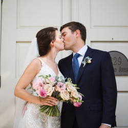 Bride and groom exchange a kiss after their small wedding ceremony planned and coordinated by Magnificent Moments Weddings