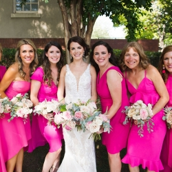 Bride poses with her bridesmaids during her summer wedding ceremony at Bonterra Wine Room