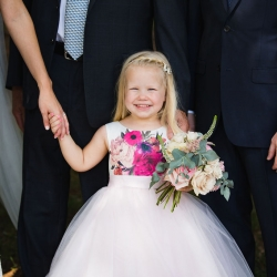 Sweet flower girl smiles for Grace Hill Photography during a summer wedding planned and coordinated by Magnificent Moments Weddings