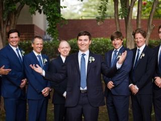 Groom poses with his groomsmen outside of Bonterra Wine Room after their wedding ceremony captured by Grace Hill Photography