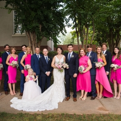 Bride and groom pose with their bridal party outside of Bonterra Wine Room in Uptown Charlotte North Carolina