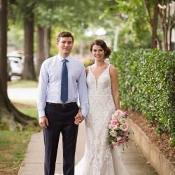 Bride and groom smile for Grace Hill Photography after exchanging vows at Bonterra Wine Room in Uptown Charlotte