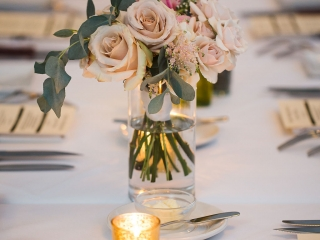 Grace Hill Photography captures the stunning tables scape covered roses and gold votives at Bonterra Wine Room