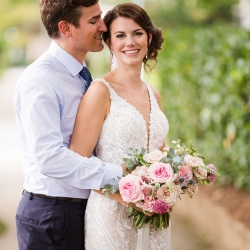 Bride smiles for Grace Hill Photography after her intimate wedding ceremony at Bonterra Wine Room