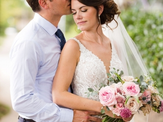 Bride and groom share a sweet embrace captured by Grace Hill Photography