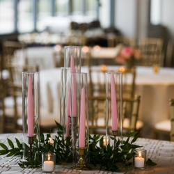 Vintage gold candles sticks hold pink taper candles and give off the most romantic glow for a summer wedding at Terrace at Cedar Hill