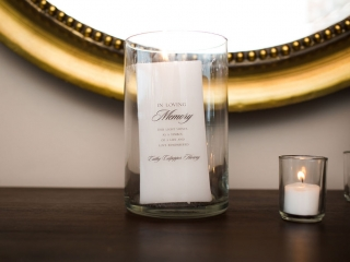 Memorial candle pays tribute to the grooms late mother during a summer wedding in Uptown Charlotte