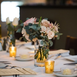 Bridesmaids bouquets double as centerpiece during a summer wedding at Bonterra Wine Room