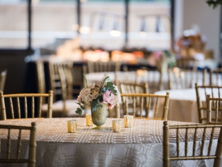 Simple gold vases filled with blush roses are the perfect accents created by Spring Vine Design for a summer wedding at Terrace at Cedar Hill