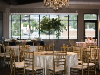 Gold chavari chairs and geometric linens are perfect modern accents set off by tall greenery centerpieces created by Springvine Design