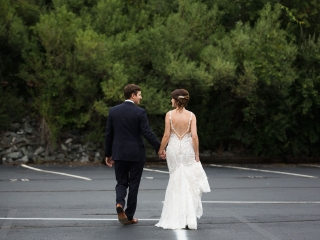 Bride and groom share a stroll captured by Grace Hill Photography