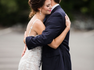 Bride and groom embrace for Grace Hill Photography as they prepare for their summer wedding reception at Terrace at Cedar Hill