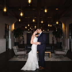 Bride and groom share a sweet moment at Terrace at Cedar Hill before their cocktail wedding reception