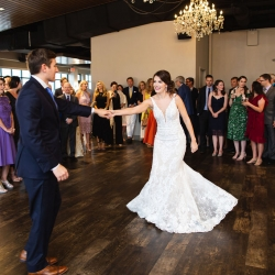 Bride and groom share a first dance during their cocktail reception at Terrace at Cedar Hill