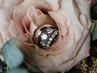 Grace Hill Photography captures the details of a bride and grooms rings during a summer wedding at Terrace at Cedar Hill