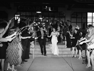 Bride and groom exit their wedding reception at Terrace at Cedar Hill captured by Grace Hill Photography