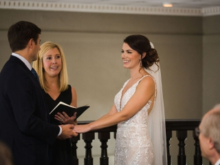 Bride and groom exchange vows and rings during a wedding ceremony captured by Grace Hill Photography